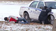 Tactical team training : Gun shoot victim and suspect shooting Stock Footage