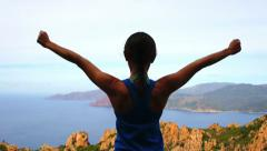 Young woman with arms outstretched looking to a sea HD Stock Footage