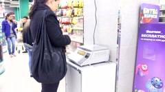 ASTRAKHAN, RUSSIA - OCT 19, 2014 Women bying in retail store, self service. Stock Footage