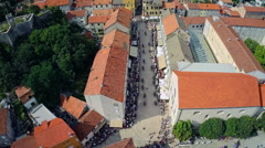 Alka procession in center of town Sinj, aerial shot Stock Footage