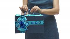 Woman Torso Holding Blue Gift Bag Stock Footage
