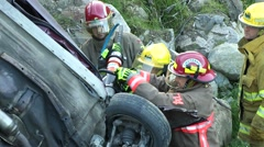 Car accident : falling on rock and firefighter need to use cutter Stock Footage