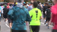 Runners in marathon through the city streets of Toronto Stock Footage