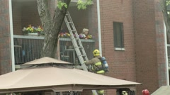 Firefighters rescues old peoples Stock Footage