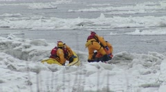 Firefighters rescue a man on ice Stock Footage