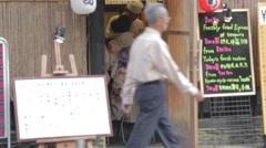 Japanese woman in kimono eats Stock Footage