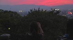 close shot of  golden sunset of Kyoto from Kiyomizu-dera - tourists - stock footage