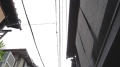 Tilt - high to low in a small street in Gion Stock Footage