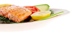 Roast salmon fish with tomatoes Stock Footage
