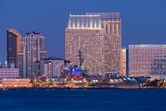 uss midway and san diego. - stock photo