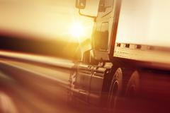 Semi truck in motion. speeding truck on the highway. Stock Photos