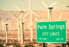Palm springs city limits highway sign and wind turbine Stock Photos