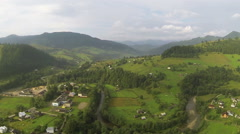Mountain landscape withe village and  wood. Aerial  shot  Stock Footage