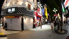 Pan of Busy Shinjuku Entertainment / Shopping District at Night - Tokyo Japan Stock Footage