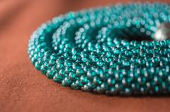 necklace from beads of color aquamarine close up - stock photo
