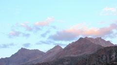 Clouds in light the setting sun. Time Lapse. Tajikistan - stock footage