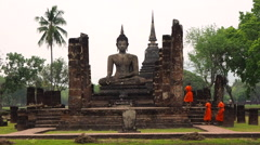 Buddhist Monks at Wat Mahathat Temple Ruins, Sukhothai Historical Park, Thailand Stock Footage