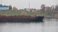 Logs barging on open top pulpwood barge, long vessel motion Stock Footage