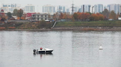 Fishing from the motorboat on Neva river in St Petersburg city, suburbans Stock Footage