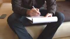 White businessman writing notes on papers sheet, clipboard and pen use, studying Stock Footage