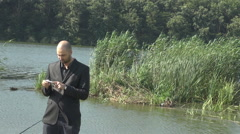 Businessman suit and tie wear, using outdoors smartphone, digit on touchscreen Stock Footage