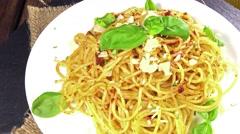 Spaghetti with pesto (loopable) Stock Footage