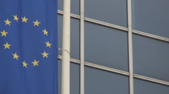 European Union huge flag waving, soft wind, politics building background outside Stock Footage