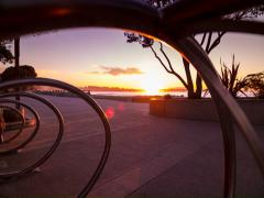5k Dolly time lapse, Sunrise on beachside walkway with metal art piece Stock Footage