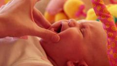 Mother caressing her baby Stock Footage