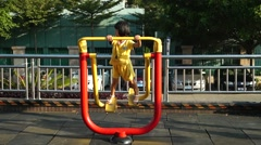 In Chinese children do swing movement, in the Shenzhen Baoan Stadium Stock Footage