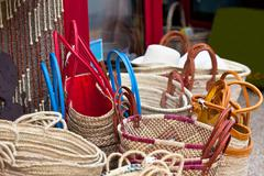 handmade wicker female bags at french market - stock photo