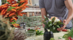 Tracking shot of a flower designer preparing a composition for a wedding 4K Stock Footage