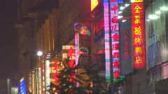 Colorful neon sign crowded Beijing shopping street commercial road China symbol  Stock Footage