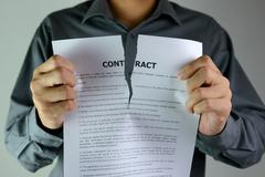 tearing contract - stock photo