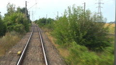 Timelapse POV point of view train pass fast motion countryside land sunny day  Stock Footage