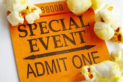 """special event"" ticket stub and popcorn closeup - stock photo"