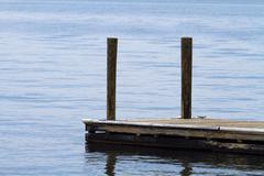 Old Weathered Boat Dock At The Lake - stock photo