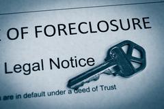 Foreclosure legal notice and house key macro Kuvituskuvat