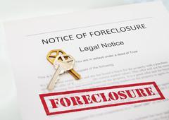 Notice of foreclosure document and house key Kuvituskuvat