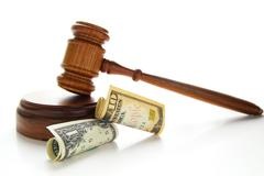 law gavel with cash, isolated on white - stock photo