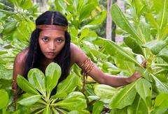Indian woman hidden in jungle Stock Photos