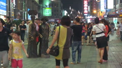 Busy shopping area night Guangzhou China town crowded pedestrian street people  Stock Footage