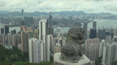 Pan right Hong Kong Island Kowloon Island Pearl River leon statue skyscrapers  Stock Footage