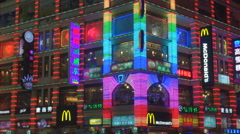 Colorful neon sign Chinese building Guangzhou shopping area night tourism asian  Arkistovideo