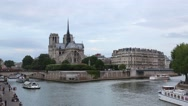 Stock Video Footage of Notre Dame cathedral in Paris with Seine river view