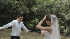 The bride and groom fool around and having fun in the park Stock Footage