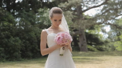The groom sensually kisses his  young bride in the park - stock footage
