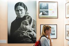 a woman tourist at war remnants museum, saigon - stock photo
