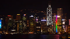 Time Lapse Pan of Victoria Harbour / Hong Kong Skyline Night - Hong Kong China Stock Footage