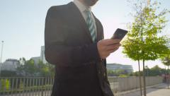 CLOSE UP: Young businessman texting on his smartphone Stock Footage